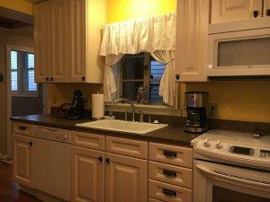 Kitchen sink next to cabinets in kitchen