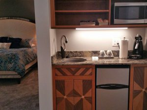 Kitchenette with dishwasher, microwave, and sink