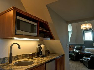 Kitchenette with sink, microwave, and coffee maker