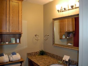 Mirror in bathroom above sink countertop
