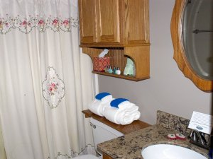 Towels in bathroom next to shower and sink