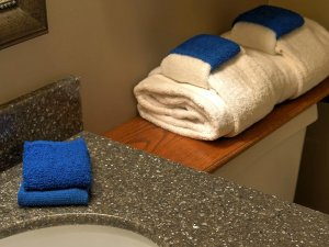 Towels on and next to sink countertop