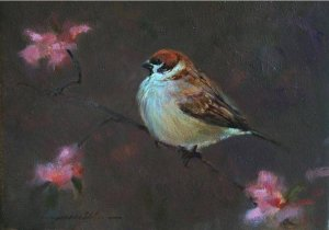 small bird amidst blossoms