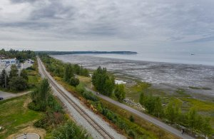 Birdseye view of train tracks by coastline