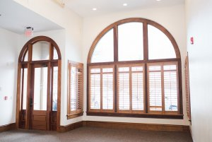 Tall curved windows in open room