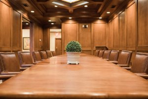 Leather seats lining long conference table