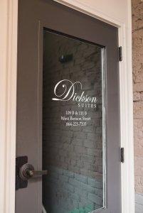 Dickson Suites sign on glass door