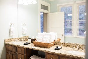 Bathroom counter with long mirror and sinks