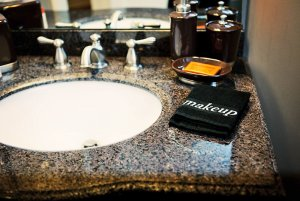 Sink and hand towel on granite counter