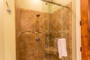 Glass door shower with towel rack
