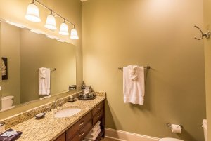 Long bathroom mirror above sink