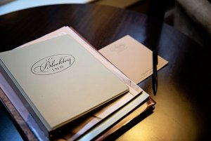 Bleckley Inn binders and booklets on table