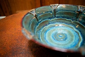 Decorated ceramic bowl on table