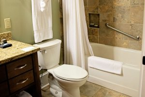 Towel rack and toilet next to shower