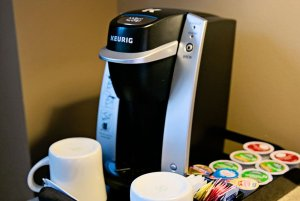Coffee maker with mugs and coffee mix-ins