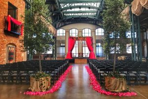 Walkway between seating lined with rose petals