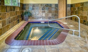 Hottub in corner of pool room