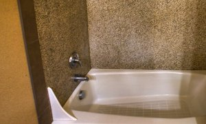 Bathtub with granite walls