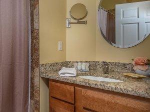 Shower next to sink in bathroom