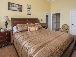 King-sized bed in bedroom