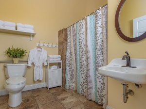 Bathroom with sink, shower, and toilet