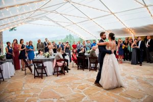 bride and groom dancing under wedding tent