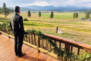 father of the bride looking from balcony at couple