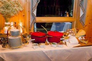 crock pots of food on a buffet table