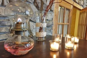 candles and oil lamp on table