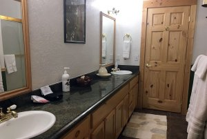 Countertop with two sinks in bathroom