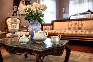China teaset and vase of flowers on small table