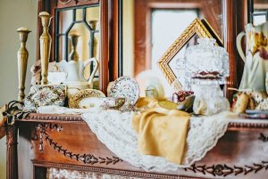 Chinaware on mantle of fireplace