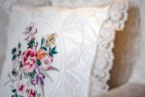 Pillow with lace and threaded flower print