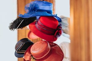 Vintage women's hats hung on hat rack