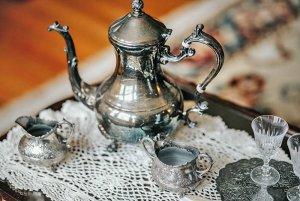 Small tin tea set on tabletop