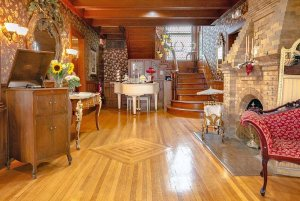 Record player, Fireplace, vanity, and piano in front entryway