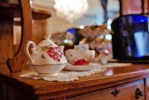 Small porceline tea set on cabinet