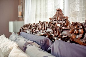 Pillows set in front of lavish headboard of bed