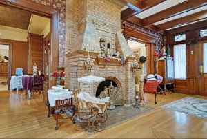 Carriage and stone fireplace in central entry room