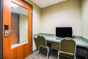 business center with computer and chairs