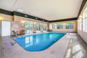 large indoor pool with lounge chairs