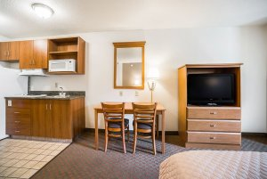 television, dresser, table, and chairs