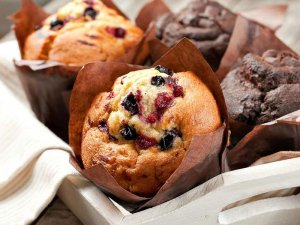 Blueberry and chocolate muffins in tray