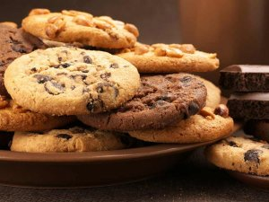 Plate stacked with chocolate chip cookies