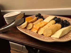 Rows of crackers and cheese on a tray