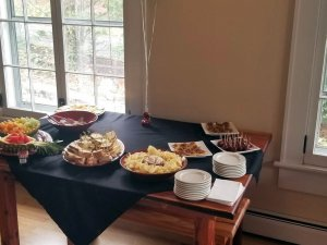 Dessert table with plates of snacks