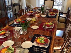 Dining table set with plates of salads