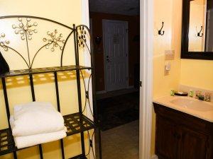 Closet doors next to chair and desk