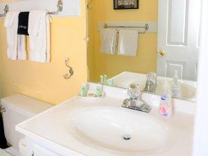 Sink in bathroom next to toilet