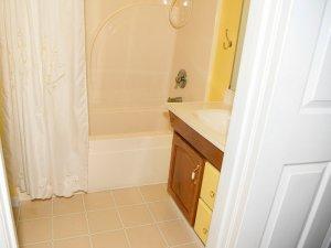 Sink and shower through doorway to bathroom